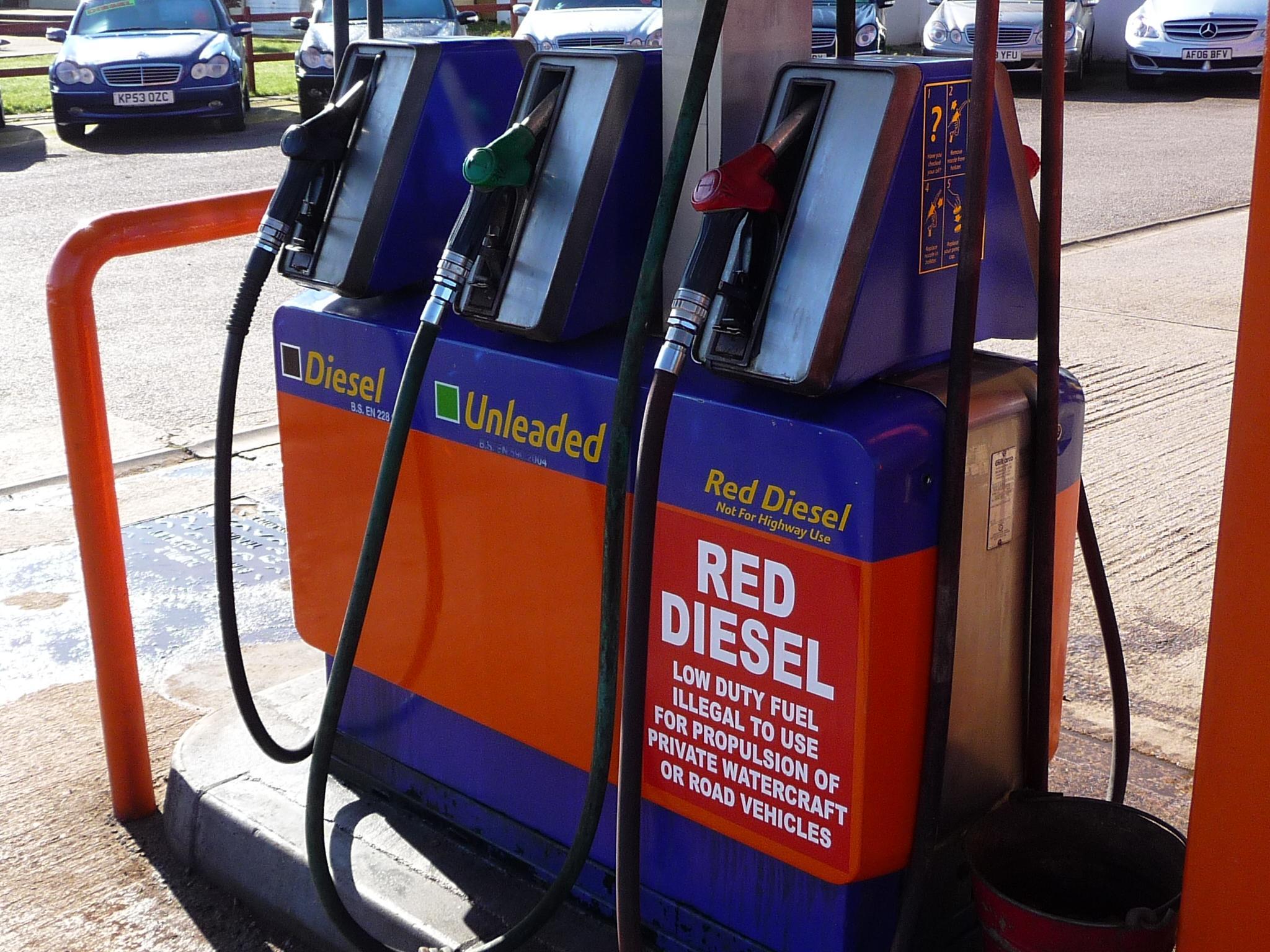 red diesel pump next to a diesel and unleaded pump - misfuel potential